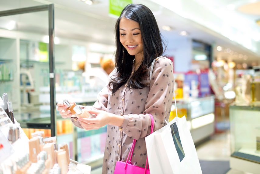 female shopping for cosmetics
